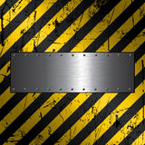 Metal plate on grunge background Royalty Free Stock Photos