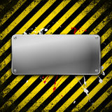 Metal plate on grunge background. Stock Image