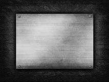 Metal plate on grunge grill background Stock Photo