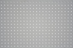 Metal plate with hole pattern Stock Photo