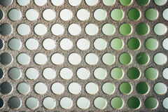 Metal plate with many small circular holes, macro texture backgr Stock Photography