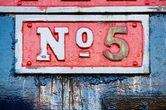 Metal Plate with Number Five. Close-up of a number five sign on the side of an old British Steam engine Stock Image