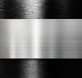 Metal plate over black brushed aluminum background Royalty Free Stock Photo