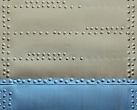 Metal plate with rivets Royalty Free Stock Image