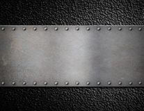 Metal plate with rivets background Stock Images