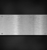 Metal plate with rivets over grate Stock Image