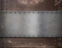 Metal plate with rivets over rustic steel Royalty Free Stock Images