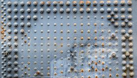 Metal plate with rivets and screws Stock Photography