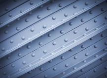 Metal plate with rivets, textural background Stock Photo