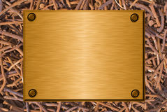 Metal plate and rusty nails. Shiny brushed metal plate against rusty nails background Royalty Free Stock Photos