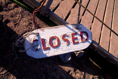 Metal plate on the sand tells that closed Stock Photos