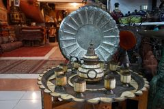 Metal plate in shop. Metal plate in the antique shop in Morocco stock photo