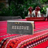 Metal Plate With Sign Reserve In The Ethnic Food Restaurant Royalty Free Stock Photography