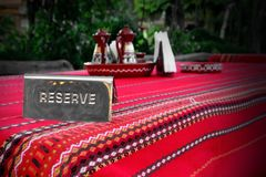 Metal Plate With Sign Reserve In The Ethnic Food Restaurant Stock Image