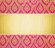 Metal plate and Thai traditional pattern. Abstract gold metal plate and Thai traditional classic pattern background. Thai traditional classic pattern sculptures Royalty Free Stock Photo