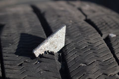 Metal plate in tire Stock Image