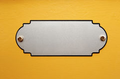 The metal plate on the wall Royalty Free Stock Image