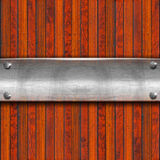 Metal Plate on Wood Background Royalty Free Stock Image