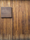 Metal plate on wood plank Stock Photo