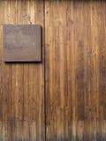 Metal plate on wood plank Stock Photo