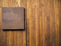Metal plate on wood plank Stock Photos