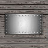 Metal plate on wooden boards. vector illustration Stock Photos
