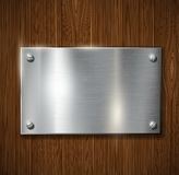 Metal plate on a wooden surface Stock Photo