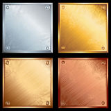 Metal plates. Set of old metallic plates with screws Stock Image