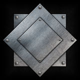 Metal plates on grunge Royalty Free Stock Photos