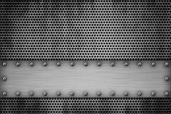 Metal plates on a metal grill. Grill pattern riveted to brushed steel background Stock Images