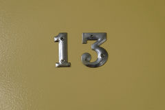 Metal plates of number thirteen. Metal plates showing the unlucky number thirteen Royalty Free Stock Image