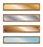 Metal plates with wood frames. Various metallic plates with rivets and wooden frame on white background Royalty Free Stock Photos
