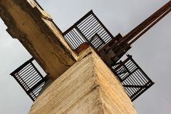 Metal platforms and railings on old concrete pole. Against the sky Royalty Free Stock Images