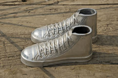 Metal plimsolls on wooden background in asia street Royalty Free Stock Image