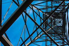Metal pole with electrical wires. High voltage electricity pylons with power lines stock image