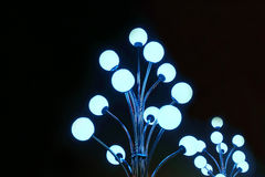 Metal pole with flashing neon lights balls Stock Images