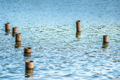 Metal poles in water Royalty Free Stock Photos
