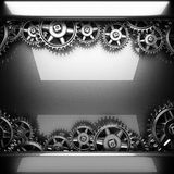 Metal polished background with cogwheel gears Royalty Free Stock Images