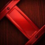 Metal pollished vermelho no bachkround de madeira Imagens de Stock Royalty Free