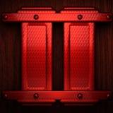 Metal pollished vermelho no bachkround de madeira Imagem de Stock