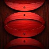 Metal pollished vermelho no bachkround de madeira Imagens de Stock