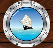 Metal porthole and tallship in the ocean Stock Photos