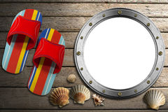 Metal Porthole on Wooden Boardwalk with Sand Royalty Free Stock Photos
