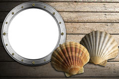 Metal Porthole on Wooden Boardwalk with Sand Royalty Free Stock Images