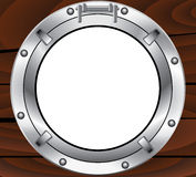 Metal porthole and wooden wall Stock Photo