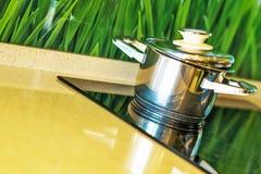 Metal pot with glass lid. Selective focus Stock Photography