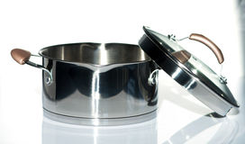 Metal pot with glass lid. Selective focus.Little of DOFF Royalty Free Stock Photography