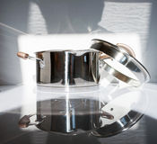 Metal pot with glass lid. Selective focus.Little of DOFF Royalty Free Stock Image