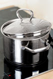 Metal pot on the stove Royalty Free Stock Photography
