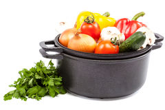 Metal pots and pans with vegetables. Royalty Free Stock Photography